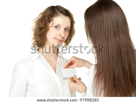 Young woman fastening blank badge to the shirt of participant of a conference/business meeting; young women at business meeting or conference isolated on white
