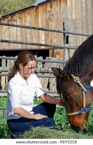Young Woman feeding horse