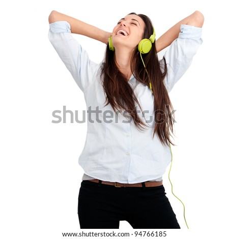 Young woman feeling happy listening music with headphones.Isolated.