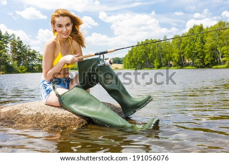 young woman fishing in pond during summer #191056076