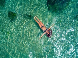 Young woman floating in the clear sea of the Black sea. Sozopol,Bulgaria