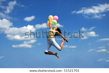 young woman flying with colorful balloons