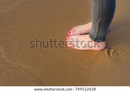 Young Woman foot going on the summer beach. Close up leg of teenager walking along wave of sea water and sand on the beach. Travel Concept  in warm climates.Copy space for text. #749522638