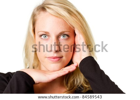 Young woman frames her face with her hands