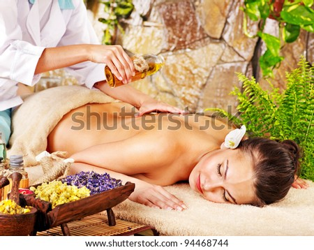 Young woman getting massage in spa