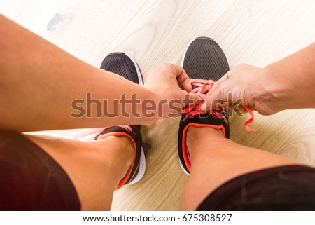 Young woman getting ready for running and lace up her schoes Stock foto ©