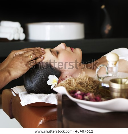 Young woman getting treatment at spa centre