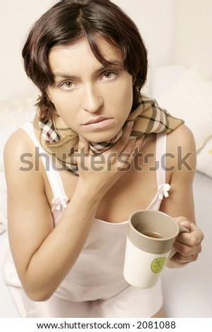 young woman, girl in a scarf drinking tea from a mug