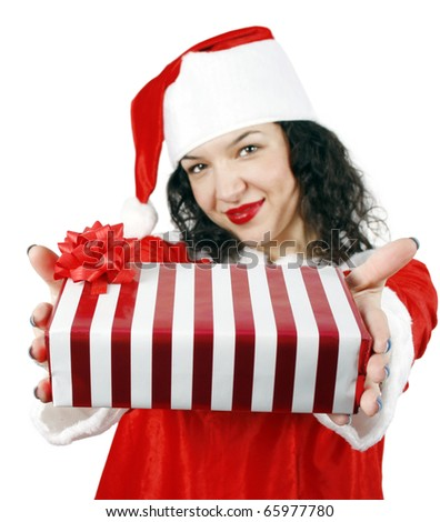 Young woman giving a gift isolated on white background