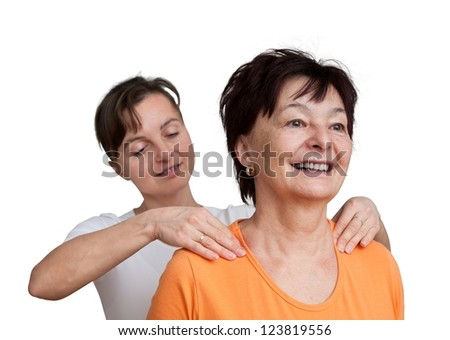 Young woman giving massage to senior - isolated on white