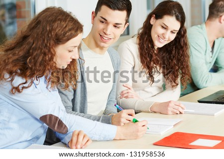 Young woman giving private lessons to school students