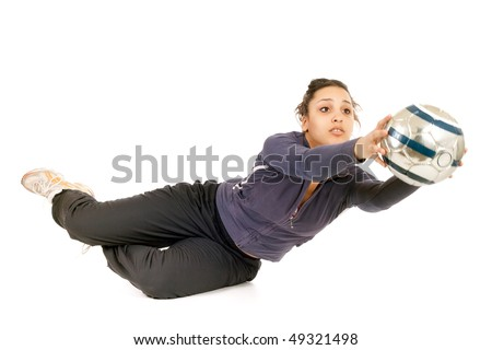 young woman goalkeeper catching ball isolated on white