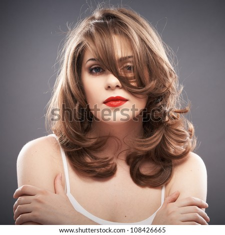 Young woman hair style portrait . isolated on gray background