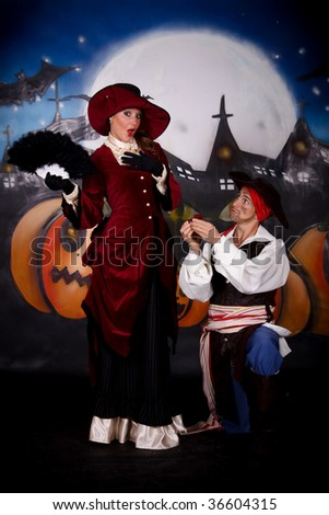 Young woman, Halloween lady with fancy hat and pirate. Studio, painted themed background. - stock photo