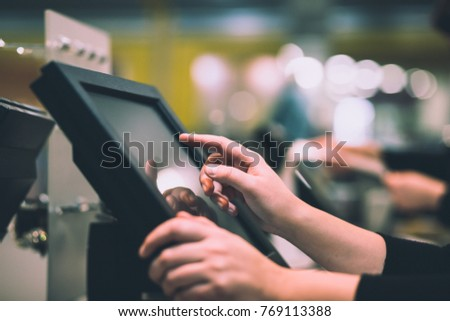 Young woman hand doing process payment on a touchscreen cash register, finance concept (color toned image) #769113388