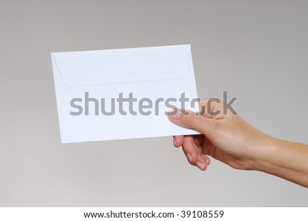 Young woman hand holding an envelope isolated on a white background.