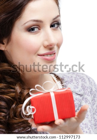 Young woman hands an International Woman's Day gift wrapped in red paper, isolated on white