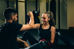 young woman handshake with her personal boxing trainer