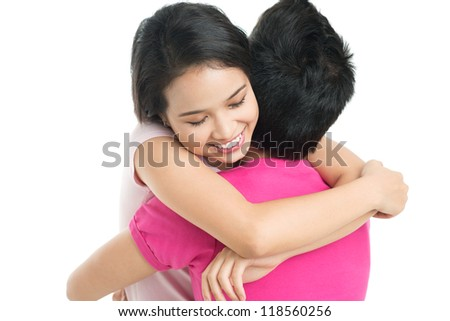 Young woman happily hugging her boyfriend