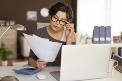 Young woman hard working at home