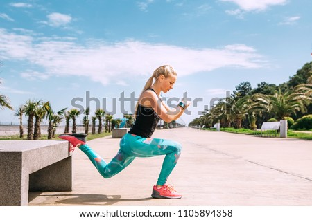 Young woman has an outdoor workout on the sea embankment #1105894358