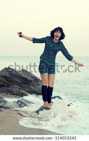 young woman has fun on the sea shore