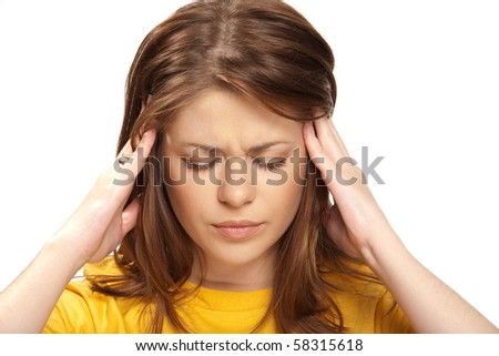 young woman having a headache close up { isolated on white }