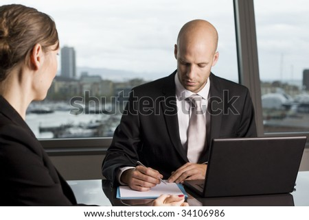 Young woman having a job interview in a beautiful office