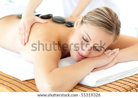 Young woman having a massage in a spa
