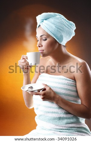 "Young woman having a morning coffee. Meant to match ""Hot coffee, sisal sack and grains"" photo series."