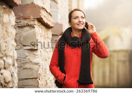 Young woman having a relaxing walk and talking on the phone