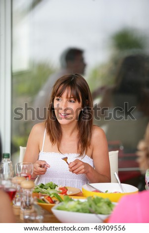 young woman having dinner with friends