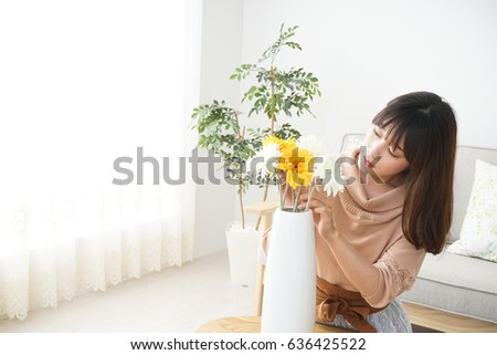 Young woman having flowers #636425522