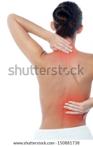 Young woman having neck and backache