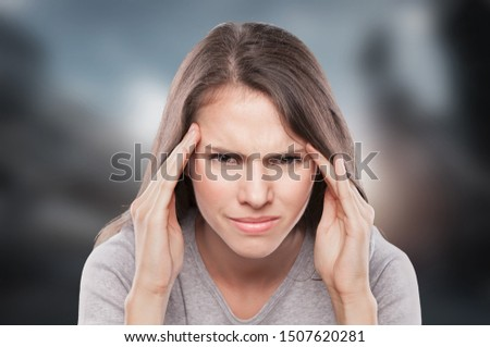 young woman having splitting headache