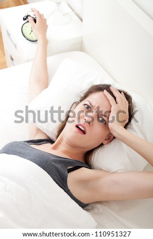 Young woman having trouble with getting up early in the morning