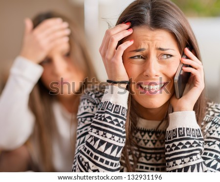 Young Woman Heard Bad News And Crying On Cell Phone
