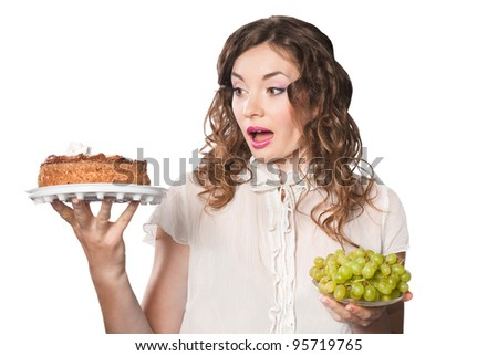 young woman hesistating kind of deliciouns isolated on white background