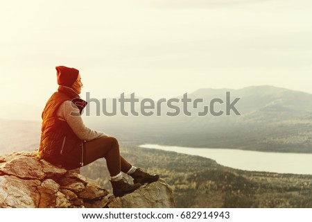 Young woman hiker enjoy the view at seaside mountain peak. Travel concept