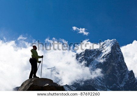 Young woman hiker hiking in Himalaya Mountains in Nepal
