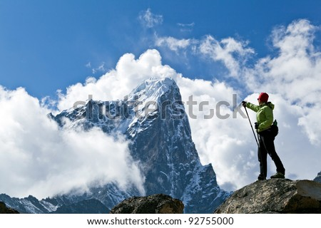 Young woman hiking in Himalaya Mountains in Nepal