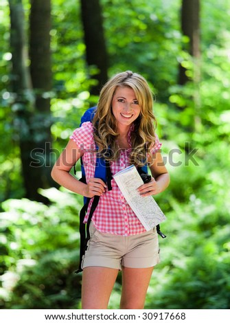 Young Woman Hiking in the recreation in the forest