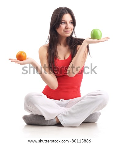 Young woman hold apple and orange