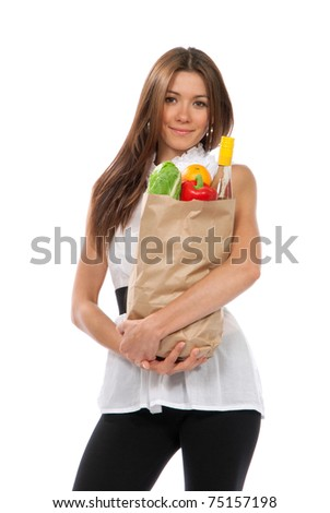 Young woman hold shopping paper bag full of vegetarian groceries, red pepper, salad, bottle of dry wine, orange  isolated on white background