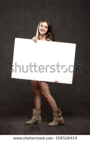 young woman holding a banner