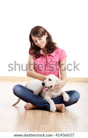 Young woman holding a beautiful and cute dog