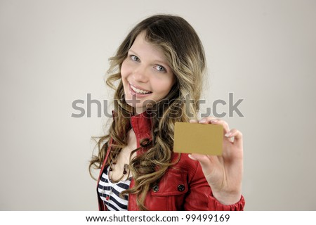 young woman holding a blank credit or gift card