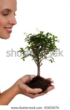 Young woman holding a bonsai tree, isolated on white. Concept: new life.