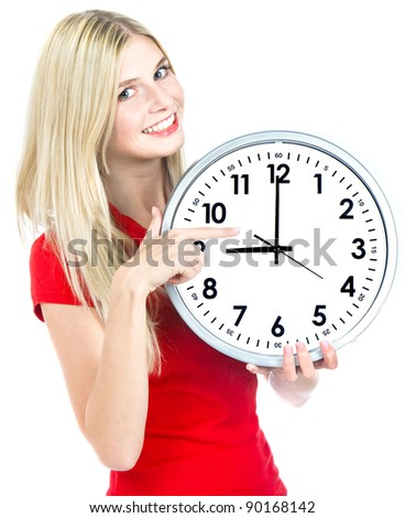 young woman holding a clock. time management concept. nine o`clock
