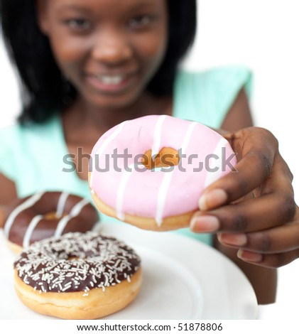 Young woman holding a donut against a white background